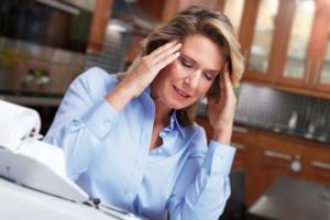 Woman having headache migraine.