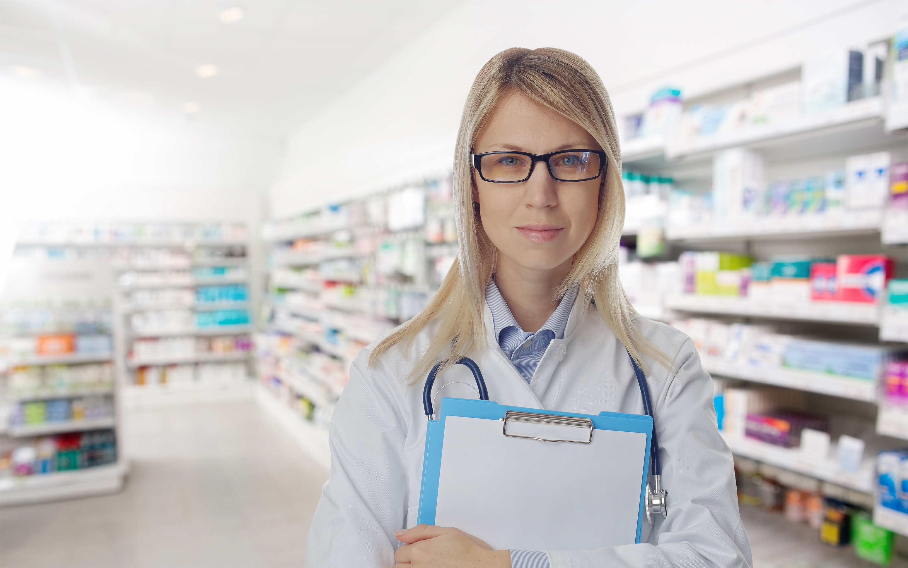 Portrait of smiling female pharmacist in pharmacy drugstore