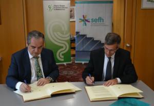 Miguel Ángel Calleja y José Luis Aguilar, durante la firma del convenio