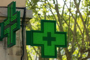 Closeup of a green pharmacy sign outside a pharmacy store in Fra