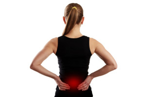 Fitness woman suffering from lumbar pain.