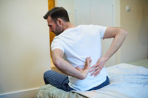 Rear view of man suffering from a backache