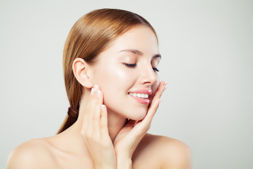 Relaxing woman with closed eyes. Nice girl with healthy clear sk