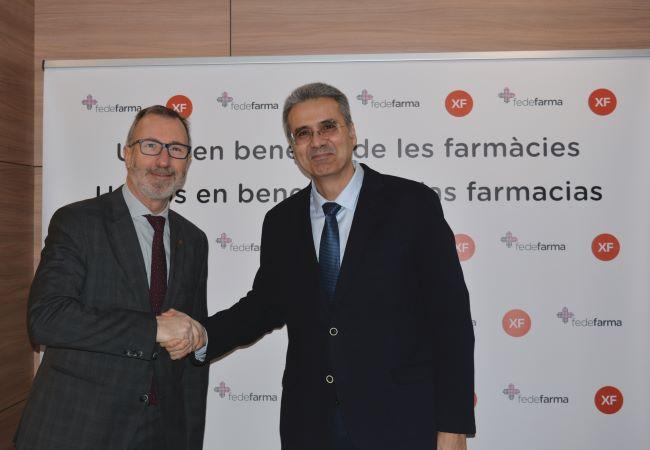 Vicenç J. Calduch y Lluís Pla Cama, a la derecha, durante la firma