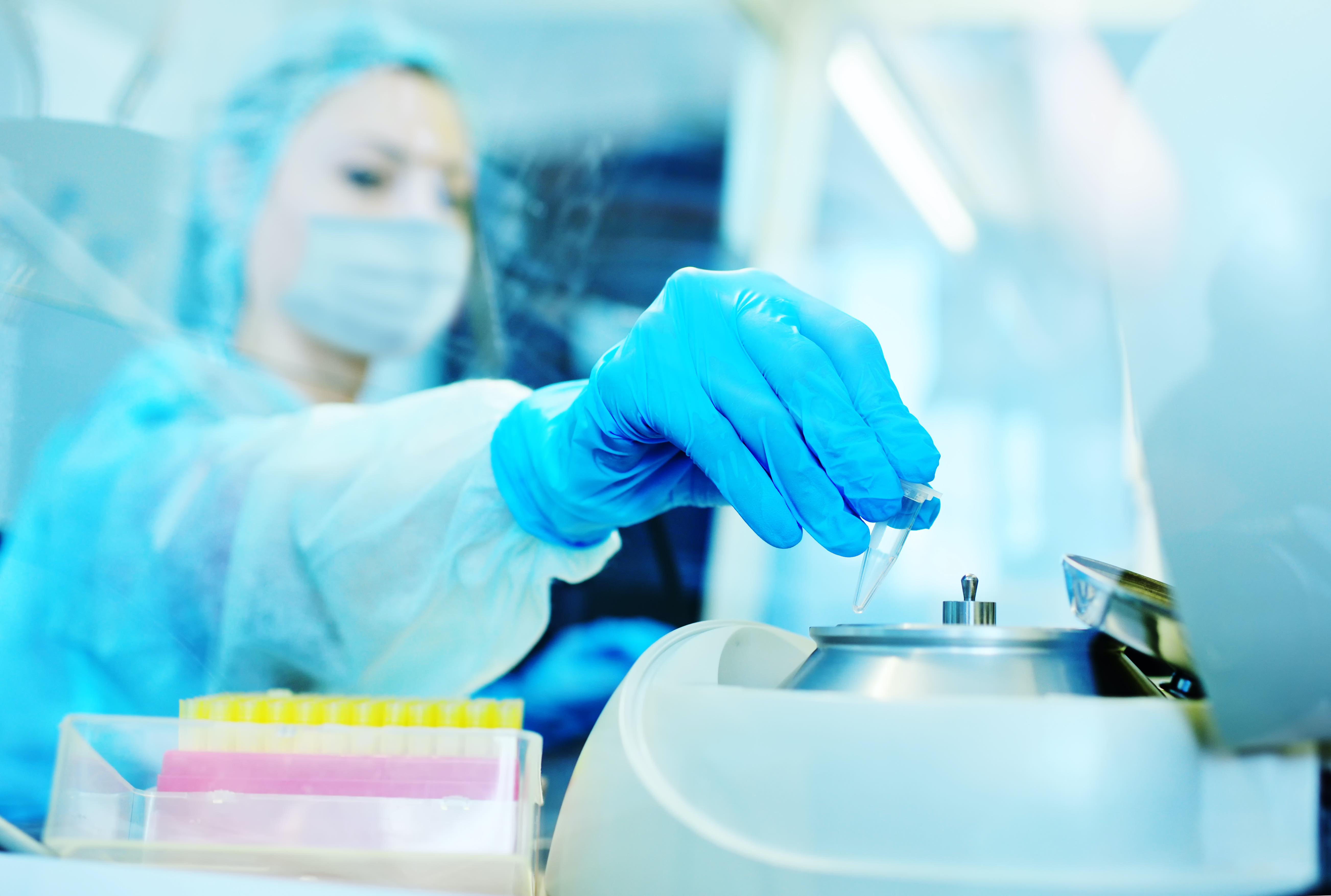 a female scientist in a protective medical mask and rubber gloves makes PCR DNA tests in a modern chemical and bacteriological laboratory.2019-nCoV; coronavirus; China;